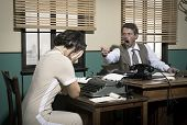 pic of 1950s  - Furious director arguing with young secretary 1950s vintage office - JPG