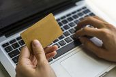 stock photo of card-making  - Hand of a woman making purchases through the Internet - JPG
