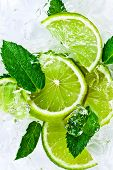 image of peppermint  - lime slices with ice and peppermint leaves - JPG