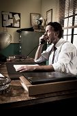 stock photo of 1950s  - Angry businessman on the phone shouting out loud 1950s vintage office - JPG