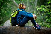 foto of woman  - Active healthy woman hiking in beautiful forest - JPG