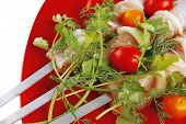 image of greenery  - raw  chicken kebabs served with cherry and greenery - JPG