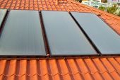 image of roof-light  - Solar water heating system on the red roof - JPG