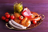 stock photo of deli  - Assortment of deli meats on metal tray on color wooden background - JPG