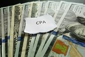 stock photo of cpa  - CPA paper scrap on money  - JPG
