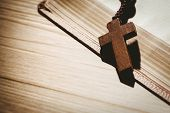 image of pentecostal  - Open bible and wooden rosary beads on wooden table - JPG