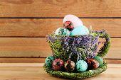 image of bird egg  - Bird colorful eggs in decorative mug on light background - JPG