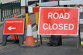 image of pedestrians  - UK road closed sign blocking road with pedestrian diversion - JPG