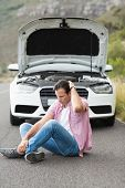 stock photo of nervous breakdown  - Stressed man sitting after a car breakdown at the side of the road - JPG