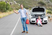 picture of nervous breakdown  - Couple after a car breakdown at the side of the road - JPG