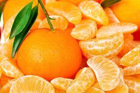 picture of mandarin orange  - fresh mandarine orange among mandarine slices closeup - JPG