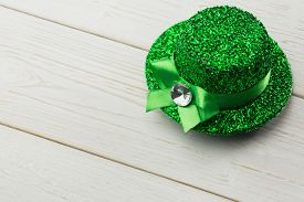 stock photo of st patty  - St patricks day hat on wooden table - JPG