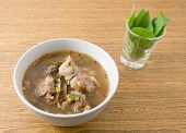 image of thai cuisine  - Thai Cuisine and Food A Bowl of Clear Spicy Hot and Sour Soup with Beef Entrails - JPG