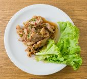 stock photo of thai cuisine  - Thai Cuisine and Food Top View of Thai Traditional Nam Tok or Spicy Grilled Beef Salad Served with Lettuce Leaves - JPG