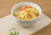 image of scallion  - Thai Cuisine and Food Thai Omelet Soup with Tomatoes Onion and Chopped Scallion on Wooden Board - JPG