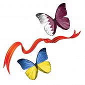 picture of qatar  - Two butterflies fluttering with flags of Ukraine and the Qatar - JPG