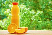 picture of orange  - Bottle with orange juice - JPG