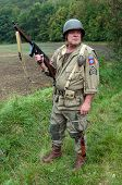 foto of sub-machine-gun  - American soldier with submachine gun second world war style - JPG