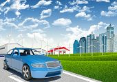 pic of petrol  - Car with wind generators and petrol station on urban background - JPG