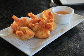 picture of dipping  - Appetizer of delicious Crab Rangoons and dipping sauce on white plate - JPG