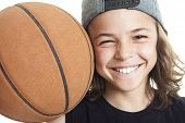 image of ball cap  - A Portrait of young boy with basket ball - JPG
