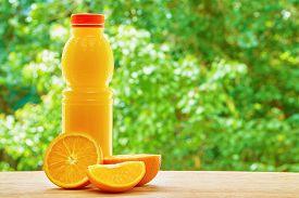 picture of orange  - Bottle with orange juice - JPG