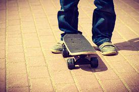 picture of skateboard  - Closeup of skateboarder legs - JPG