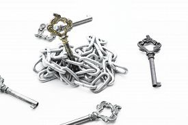 foto of skeleton key  - Vintage golden key in chain surrounding with other keys - JPG