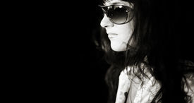 picture of streetwalkers  - woman with big sunglasses with street reflectionblack and white toned photo f - JPG