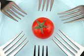 Tomaten und Gabeln