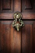 image of door-handle  - Front door with a handle in the form of the head of Castle Dracula in Transylvania - JPG
