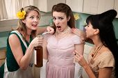 stock photo of peer-pressure  - Retro styled women pressure another lady with smoking and alcohol - JPG