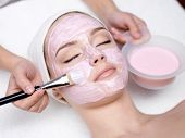 Girl Receiving Cosmetic Pink Facial Mask