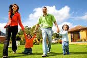 picture of happy family  - happy family having fun outdoors at home on a sunny day - JPG