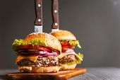 Two Mouth-watering, Delicious Homemade Burger Used To Chop Beef. On The Wooden Table. poster