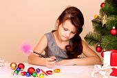 Little girl writing wish list