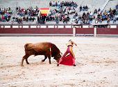 MADRID - OCTOBER 17: The matadors fancy footwork, skill and bravery before the bull that has the cro
