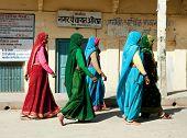 ORCHHA, INDIA -17 FEBRUARY: Group of Indian woman in beautiful sari going in Raj Mahal , February 17