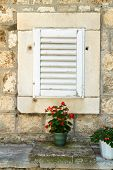 The window with wooden shutters of the old house in Korcula, Croatia