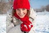 picture of snowball-fight  - Happy young woman playing snowball fight on the snow sunny day - JPG