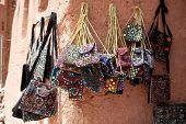Embroidered oriental patterned purses stacked on bazaar in Abyaneh, Zoroastrian village, Iran