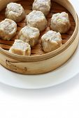 stock photo of siomai  - Shumai dumplings in a bamboo basket - JPG