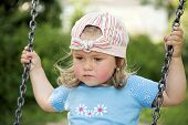 Small baby on the swings