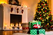 Some Nice Christmas Presents In A Living Room Filled Up With Winter Holidays Magic Atmosphere. Decor poster