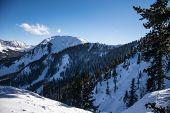Snow Covered Valley Above Taos , New Mexico With Kachina Peak Standing Tall And Perfect Powder Snow  poster