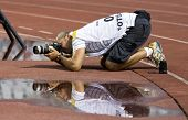 BUDAPEST, HUNGARY - AUGUST 12: Press photographer taking photographs at a friendly soccer match betw