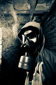 stock photo of gas mask  - Man wearing respirator or gas mask - JPG