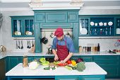Chef Cooking Vegetarian Recipe. Vegetarian Cuisine Rich Vitamins. Man Chef Wear Apron Cooking In Kit poster