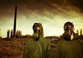 Two man wearing gas masks after nuclear disaster