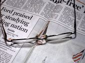 Newspaper and spectacles